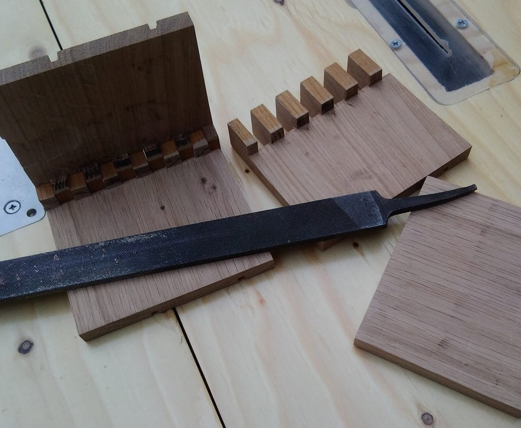 Parts for two offset boards after having cut the box joints and achieved the desired thickness.